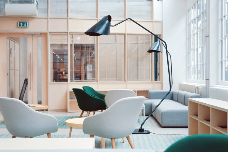 office space with gray and green chairs