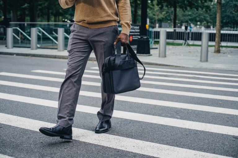 a man walking to work holding his briefcase.
