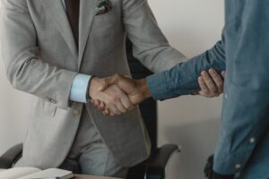 two men shaking hands at a job interview