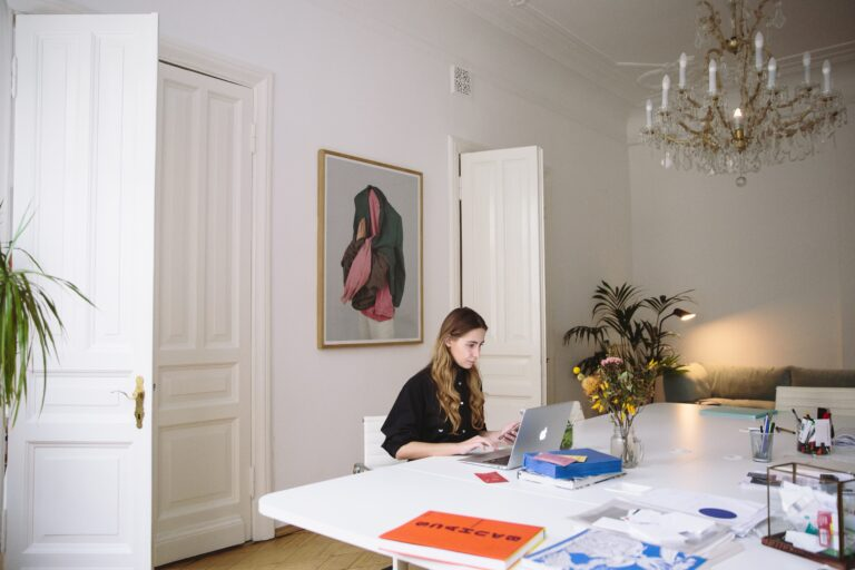 a woman working from home in her dining room