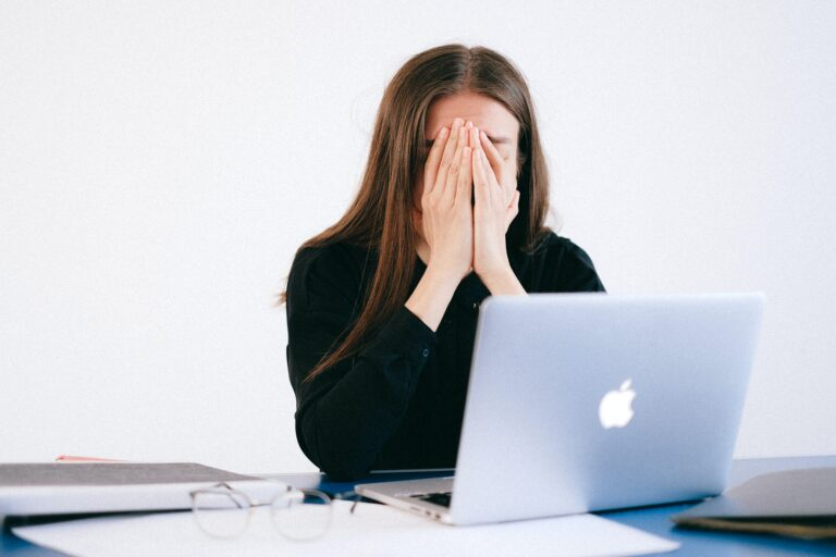 a woman stressed out while working.
