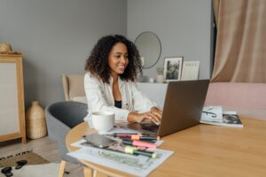 a black woman smiling while working from home