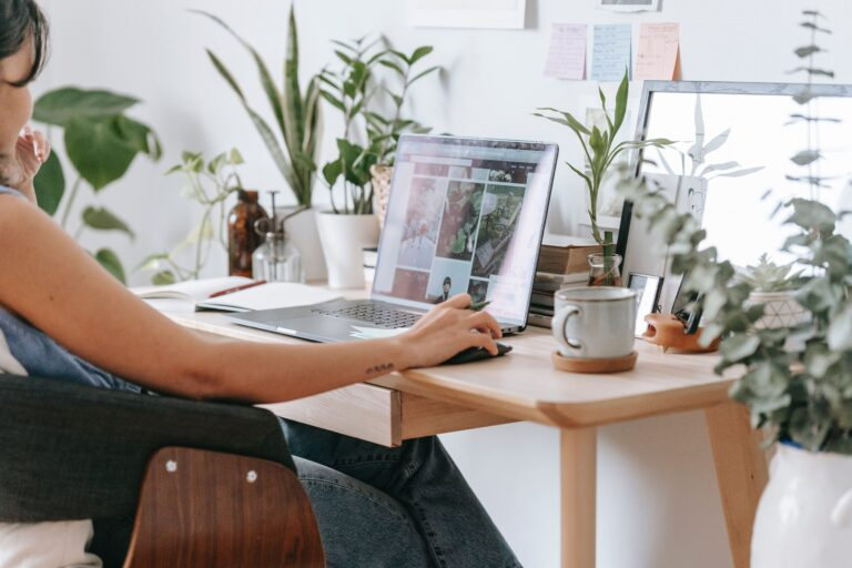 a female employee working from home with her plants.